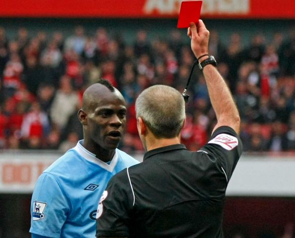 Referee giving a red card