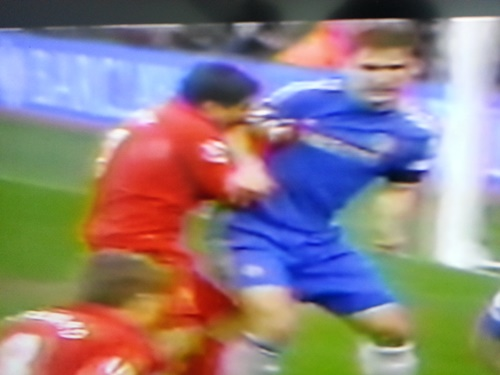 Luis Suarez bites player